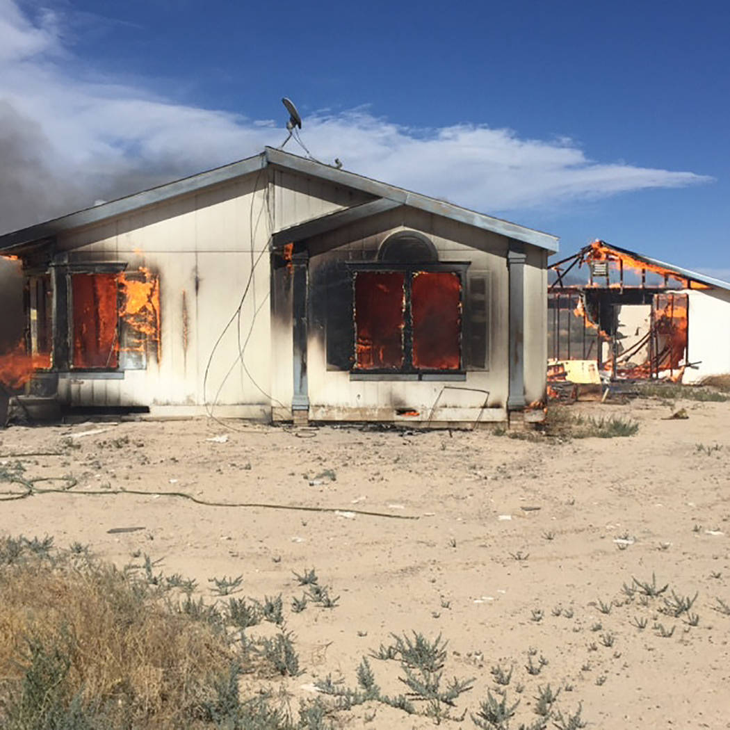 Special to Pahrump Valley Times  Gusting winds challenged fire crews battling multiple structure fires on May 24. Officials believe the fires were intentionally set. No injuries were reported. Nye ...