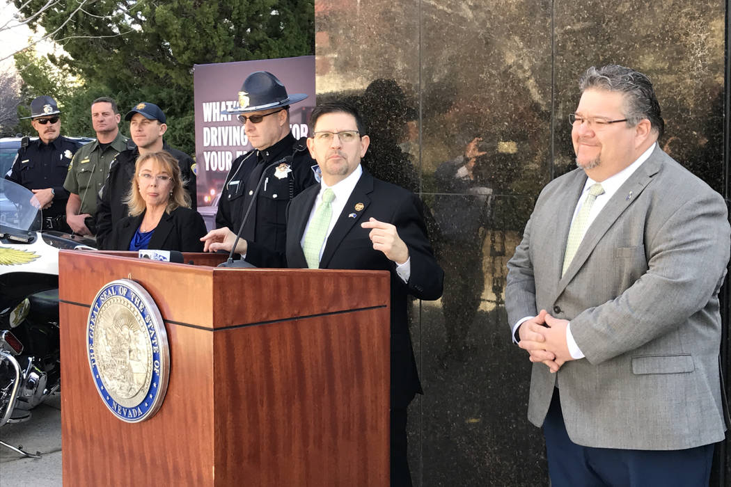Sen. Mark Manendo, center, and Assemblyman Richard Carrillo, right, discuss Senate Bill 259 requiring ignition interlocks for DUI offenders at a press conference Friday, March 17, 2017 in Carson C ...