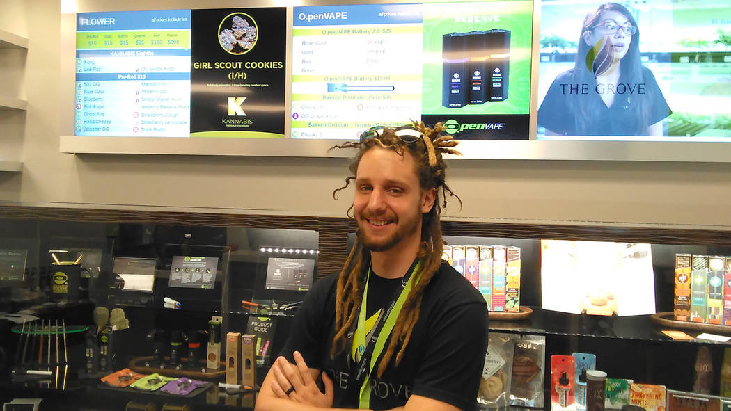 Selwyn Harris/Pahrump Valley Times Grove 'budtender' Ryan Jordan stands before scores of products at the Grove Dispensary. The medical marijuana facility is hosting a job fair from 9 a.m. to 1 ...