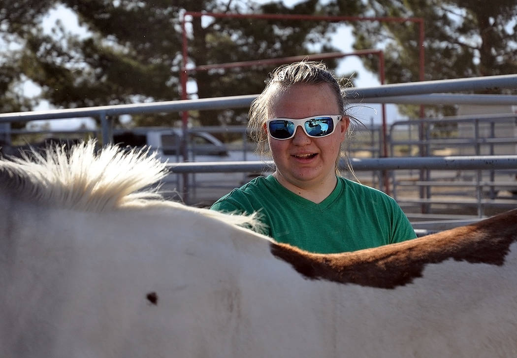 Horace Langford Jr./Pahrump Valley Times  Freshman Julie Young brushes down her horse before practice at the McCullough Rodeo Arena on May 24.