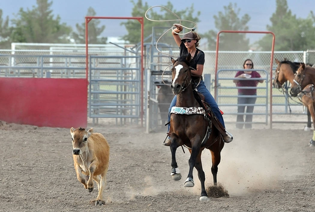 Yee-haw! Junior Korey May-Parks gets her calf during practice at the McCullough Rodeo Arena at Petrack Park on May 24.