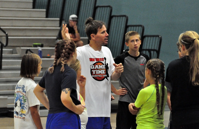 Horace Langford Jr / Pahrump Valley Times  Basketball coach Gil Llewellyn teaches some kids the finer points of the game at his camp at Rosemary Clarke Middle School on Wednesday.