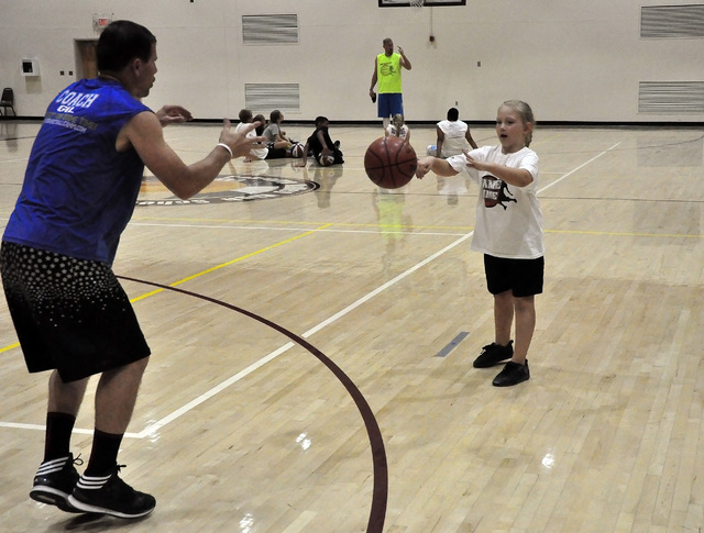 Horace Langford Jr. / Pahrump Valley Times  Coach Gil Llewellyn works with a young girl at his camp in Pahrump last year. The four-day camp starts on June 6 and will run from 9 a.m. to 3:30 p.m. f ...