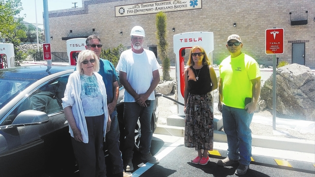 Town of Tonopah officials on June 2 welcome the first Tesla ever to be charged in Tonopah at Tesla's new supercharging station in Pocket Park.  Shown in the photo from right to left are Town Boa ...