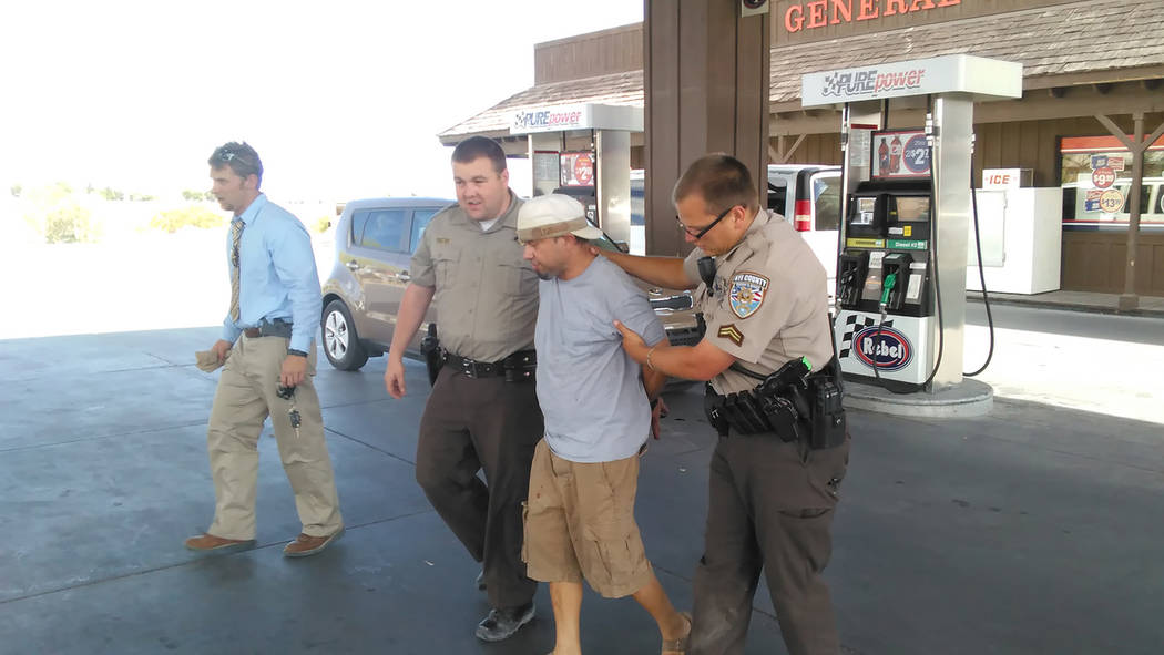 Selwyn Harris/Pahrump Valley Times  Pahrump resident Richard Adams is taken into custody on several charges, including domestic battery. Deputies located Adams at a local convenience store just be ...