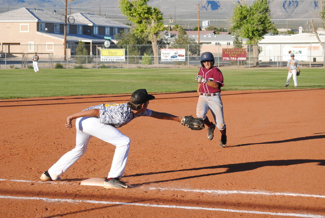 Charlotte Uyeno/Pahrump Valley Times Third baseman Dylan Keller gets the out at third base on May 20 at Ian Deutch Park in the 14U Connie Mack season opener.