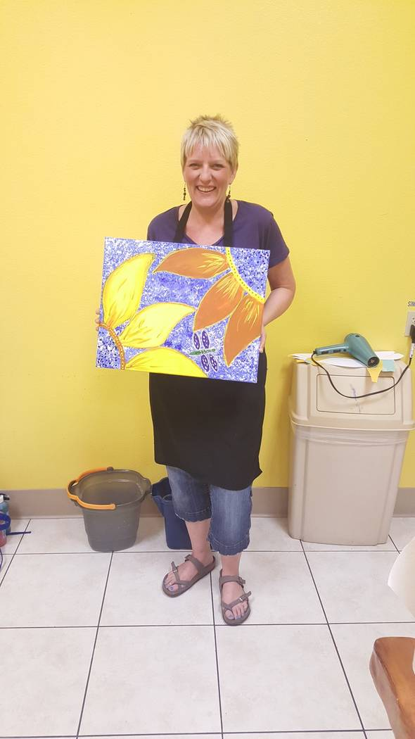 Special to the Pahrump Valley Times Local massage therapist Cassandra Suter holds up her painting after she completed a paint session with Toni Wombaker.
