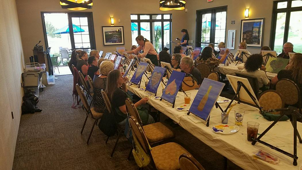"""Special to the Pahrump Valley Times Toni Wombaker, """"The painting lady"""" who owns Paint Drips and Sips,  fills the Grill Room at Mountain Falls with would be artists. She will do any amount of peopl ..."""