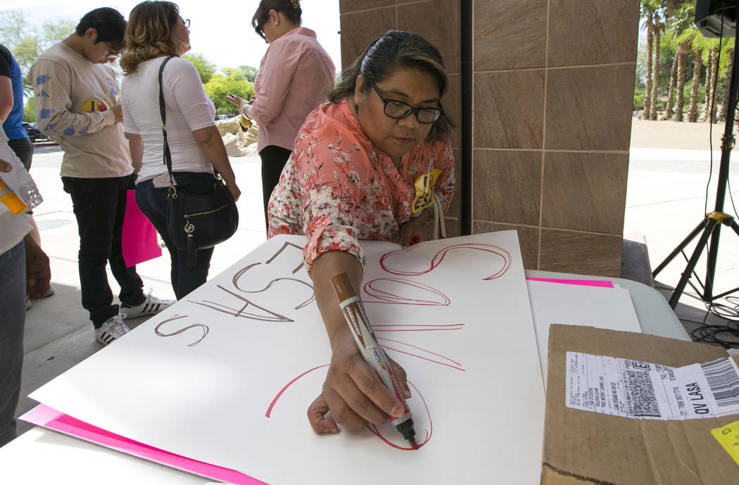 Richard Brian/Las Vegas Review-Journal A woman makes a sign before the start of a rally supporting education savings accounts, or ESAs, outside of the Sawyer Building in Las Vegas on Saturday, Jun ...