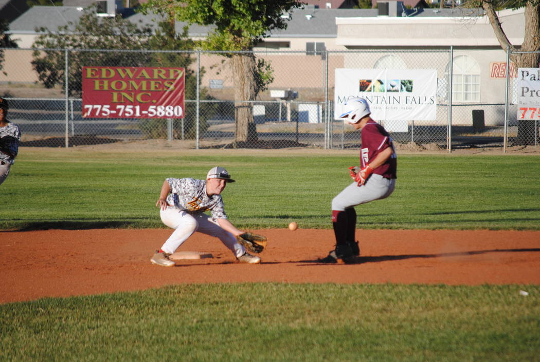 Charlotte Uyeno/Pahrump Valley Times  Ryan Braithwaite gets the out at second base on May 20 at Ian Deutch Park in the 14U Connie Mack season opener.