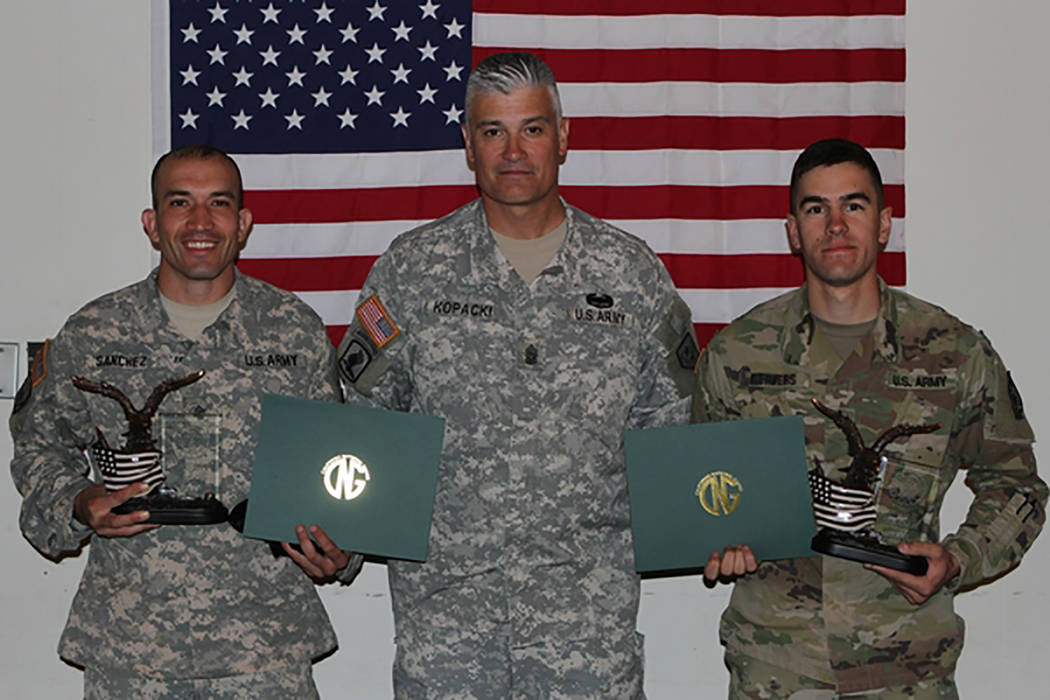 Photo courtesy Nevada and California National Guard via Defense Video & Imagery Distribution System Sgt. Osawald Sanchez, left, and Spc. Grant Reimers flank Nevada Senior Enlisted Leader Comma ...