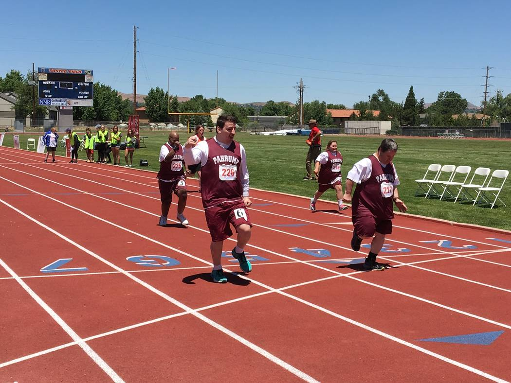 Photos by Bobbi-lee Ward/Special to the Pahrump Valley Times  Burdett Ward, Michael Turrin and Cory Fitzwater in the 25-meter run at the Special Olympics Reno Summer Games held June 9-10.