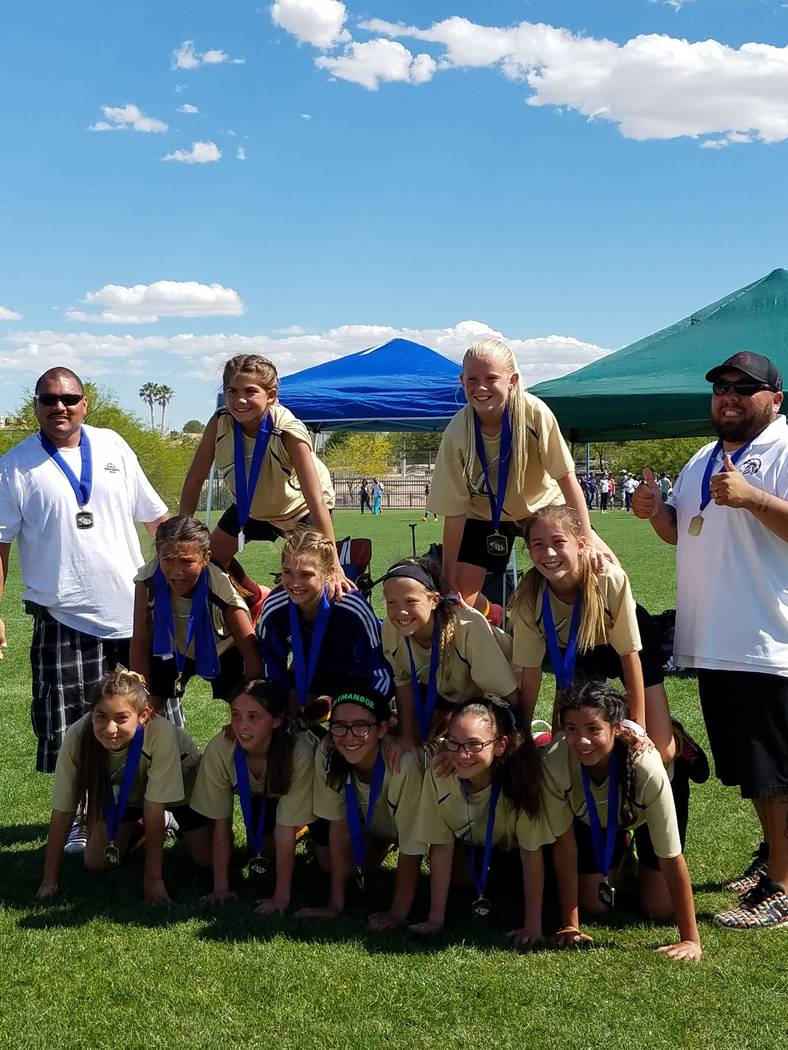 """Special to the Pahrump Valley Times  The """"05 Trojans 12U"""" team roster: Paris Coleman, Adryanna Avena, Avery Moore, Kailani Martinez, Silla Niles, Emily Lewis, Grace Miller, Andrea Sauceda, Jes ..."""
