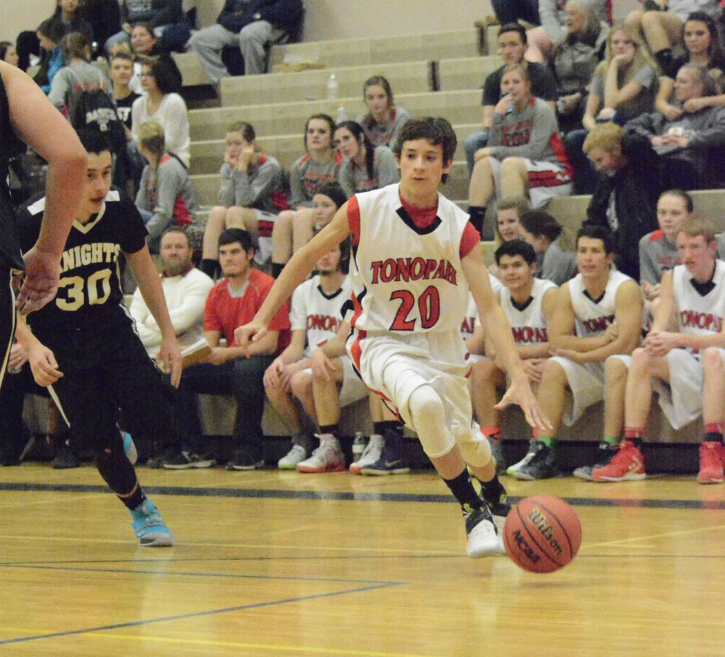 Jo Eason/Special to the Times-Bonanza & Goldfield News Derek Eason in a Muckers basketball game this year, where he played point guard.