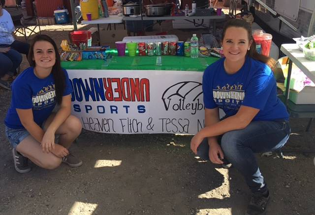 Senior Tessa North and graduate Heaven Fitch, working the concession stand at the mining park during Jim Butler Days. The two will be playing volleyball with Down Under Sports in Australia from Ju ...