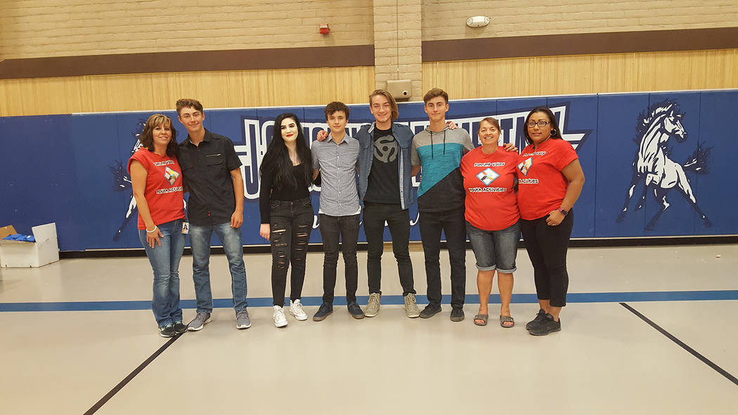 Special to Pahrump Valley Times  Pahrump Valley Youth Activities staff, clad in orange T-shirts recently visited with Pahrump's Tower of Cards band. Tower of Cards provided the kids with glow in ...
