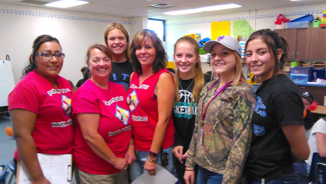 Selwyn Harris/Pahrump Valley Times  Pahrump Valley Youth Activities Director Denise Koch, center, is flanked by her staff at J.G. Johnson Elementary School where the annual summer program is now u ...