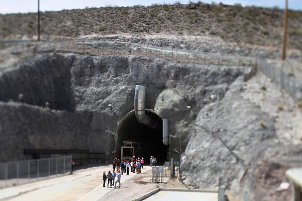 Sam Morris/Las Vegas Review-Journal Congressional staff members, media and Department of Energy employees wait for congressmen to emerge from the north portal during a congressional tour of the Yu ...