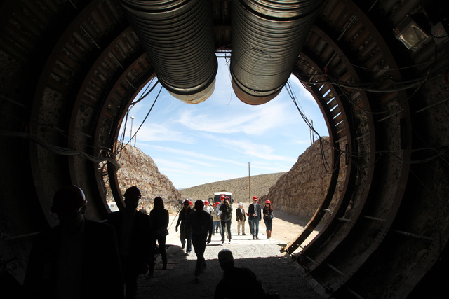 Sam Morris/Las Vegas Review-Journal Members of a congressional tour of the Yucca Mountain exploratory tunnel enter the south portal Thursday, April 9, 2015.