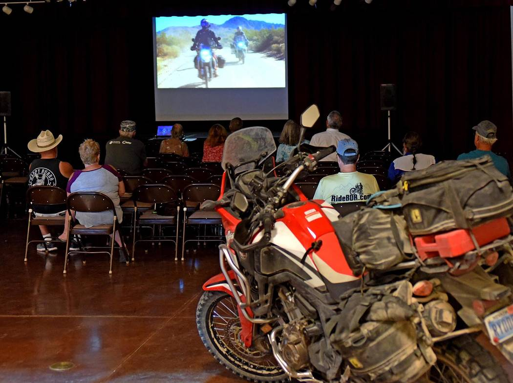 Richard Stephens/Special to the Pahrump Valley Times Local residents watch the movie in Beatty. The motorcycle in the foreground is an adventure motorcycle owned by one of the presenters. They had ...