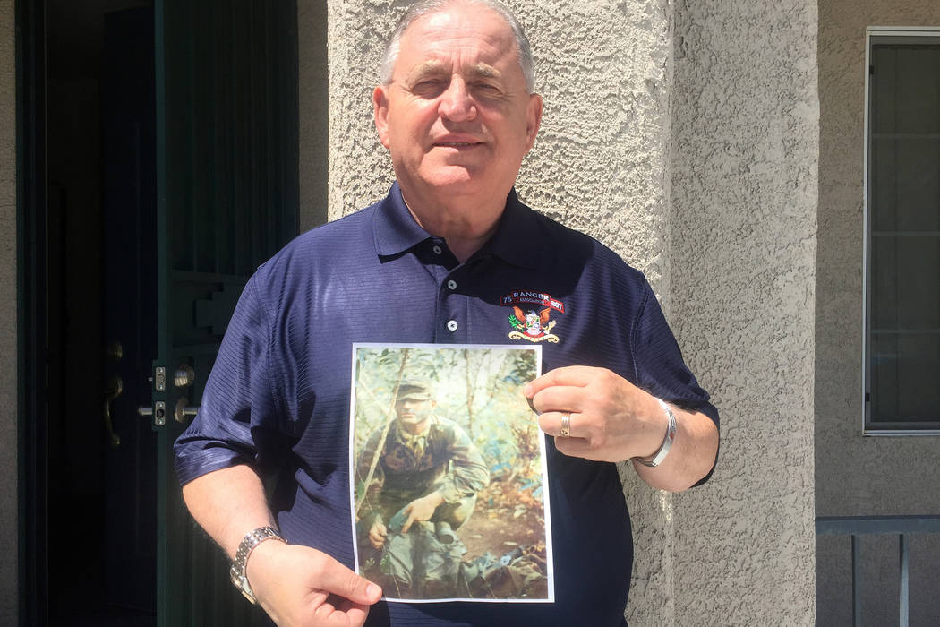 Keith Rogers/Las Vegas Review-Journal Army Ranger veteran Bill Anton holds a photo of himself in Vietnam in 1972, during an interview Wednesday, April 29, 2015, at his North Las Vegas home.