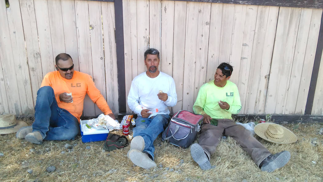 Selwyn Harris/Pahump Valley Times Three L.G. Concrete employees find a bit of shade to enjoy during their lunch break on Monday. During their workday as of late the crews take extra breaks to cool ...
