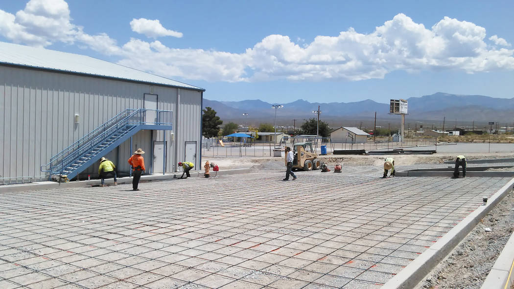 Selwyn Harris/Pahrump Valley Times  Crews from Pahrump's L.G. Concrete endure the blazing heat has they work on a parking lot project at a local church this week. the Crews arrive at the site ea ...