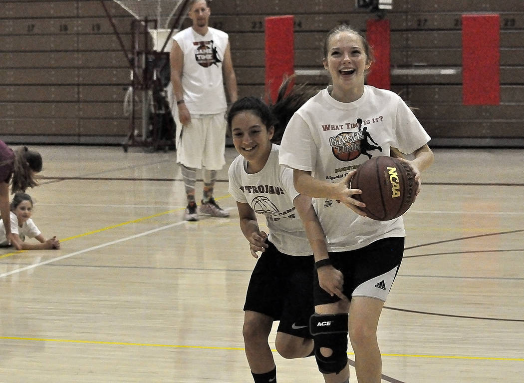 Photos by Horace Langford Jr./Pahrump Valley Times Lexi Sandoval (left) tries to defend against McKenna Robnett at the Game Time Basketball Camp last week at the Pahrump Valley High School gym.