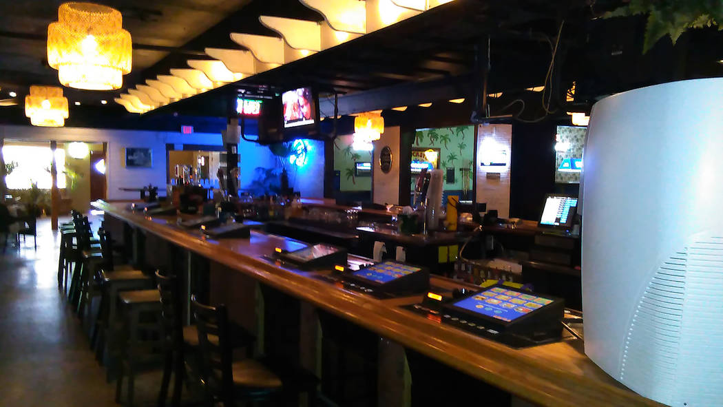Selwyn Harris/Pahrump Valley Times  Oasis Bar owner Russ Rodgers is hosting a beach party on July 8, with drink specials and giveaways. After 10 years in business, Rodger recently re-branded the b ...