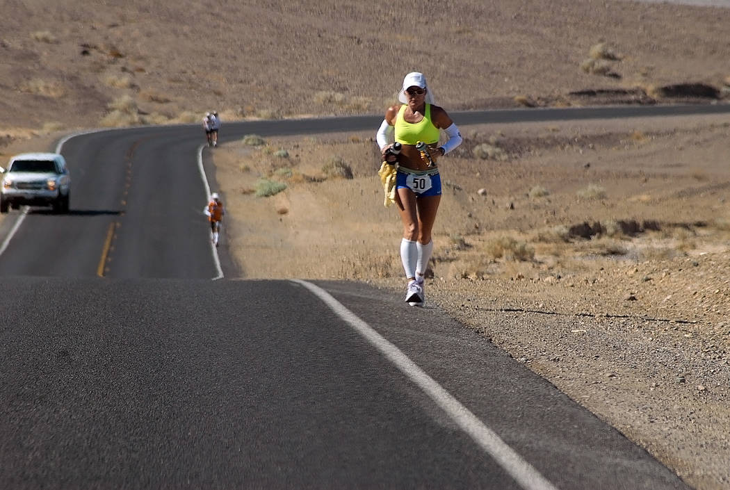 Horace Langford Jr./Pahrump Valley Times Cheryl Zwarkowski runs the Badwater 135 in 2012. Runners who have run the race say heat acclimation is an important part of the training but not the most i ...