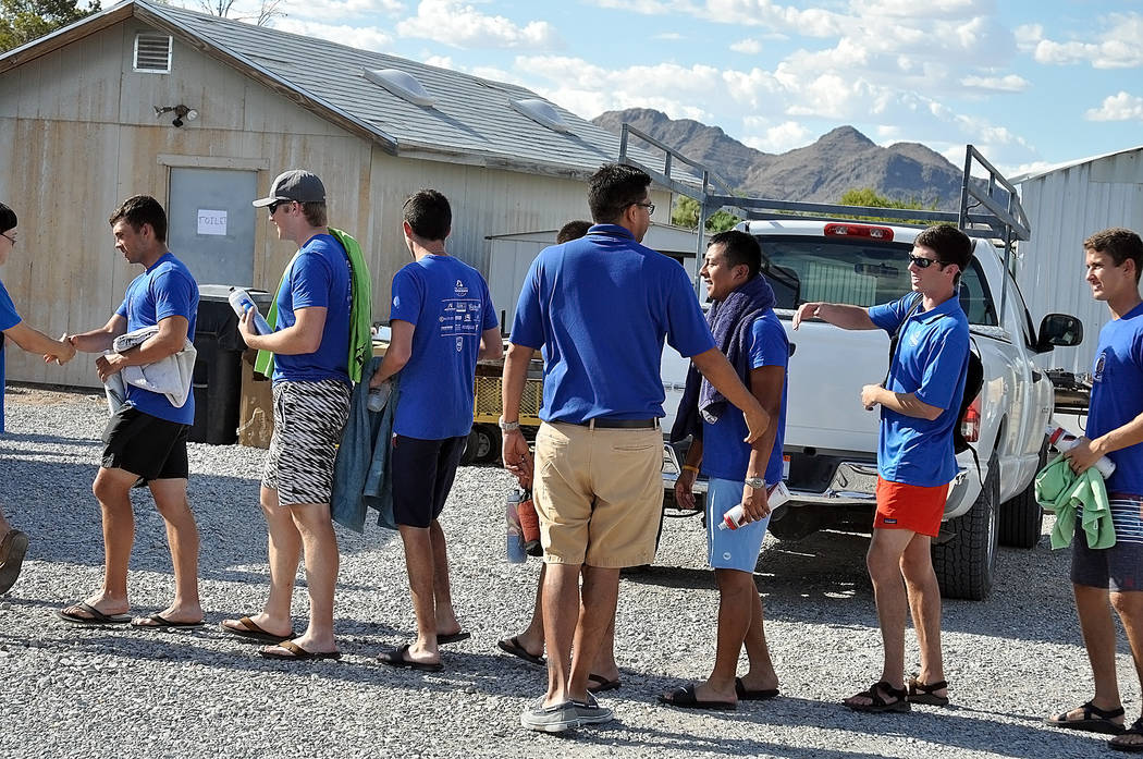 Horace Langford Jr./Pahrump Valley Times - Special Olympics Regional Director Harry Mong (center) greets Pi Kappa Phi fraternity cyclists who rode in from Barstow, California to visit with Special ...
