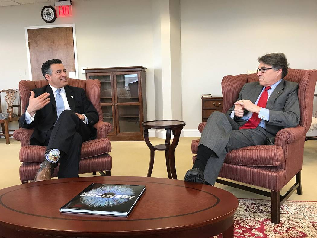 Photo provided by Nevada Governor's Office Nevada Gov. Brian Sandoval speaks with U.S. Energy Secretary Rick Perry in Washington D.C. earlier this year. Sandoval has urged the federal government t ...