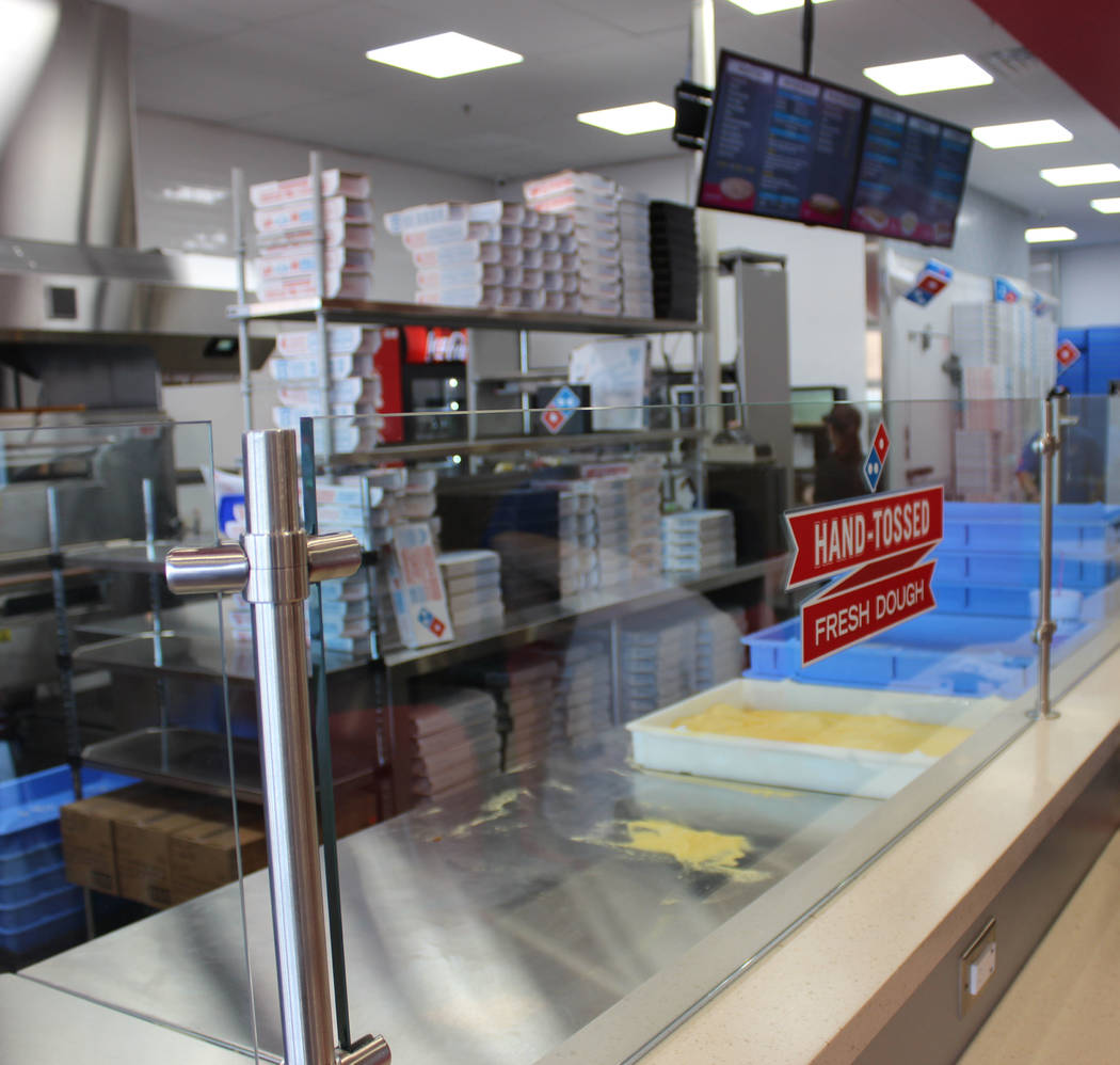 Jeffrey Meehan/ Pahrump Valley Times The viewing area at the redesigned Dominos Pizza at 250 Highway 160, Ste. 6, allows diners to have a place to hang out and catch the show at the new location a ...
