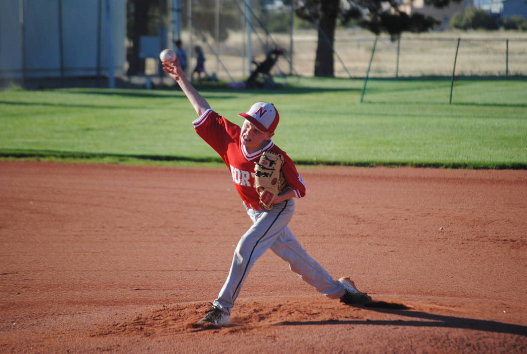 Charlotte Uyeno/Pahrump Valley Times Summerlin North pitcher Bridger Jensen on the mound in their game against Summerlin South early on in the 10-team tournament.