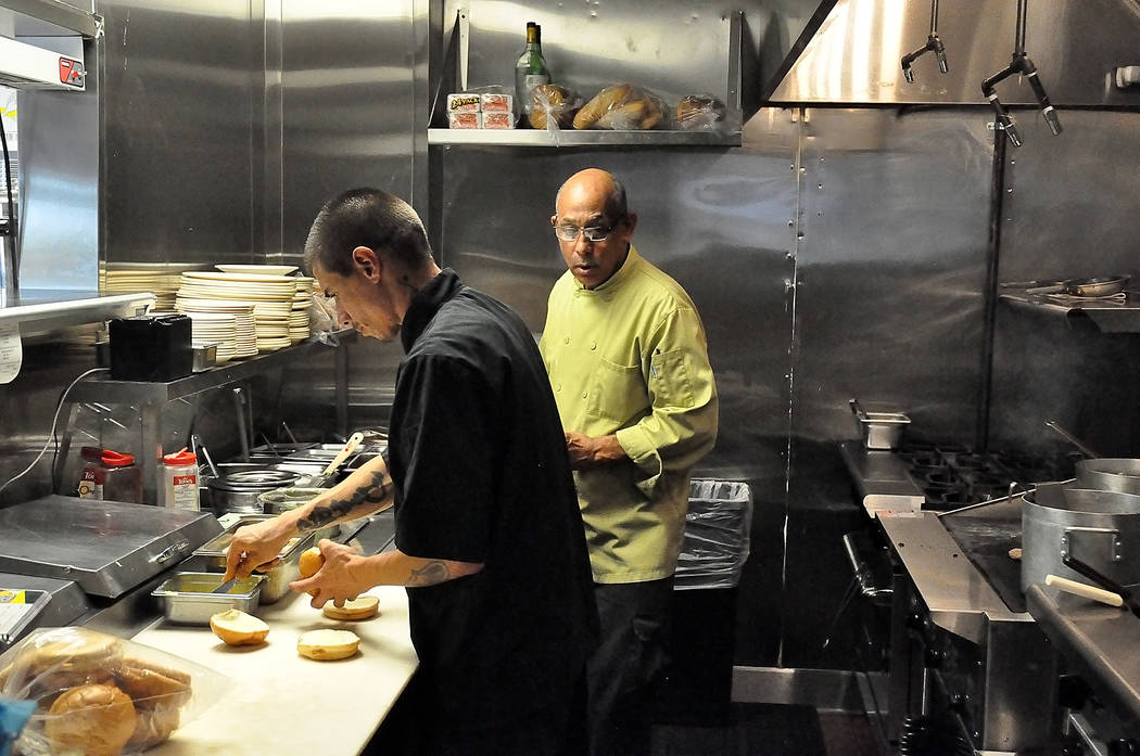 Horace Langford Jr./Pahrump Valley Times - Tony Nunez, the owner, working the line on the far right with line cook Enrique Ramirez at the new Restaurant in Pahrump called Tony's Grill.