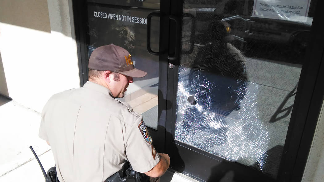 Selwyn Harris/Pahrump Valley Times  A Nye County sheriff's deputy investigates an act of vandalism Monday morning at the Nye County Administrative complex at 2100 E. Walt Williams Drive at the C ...
