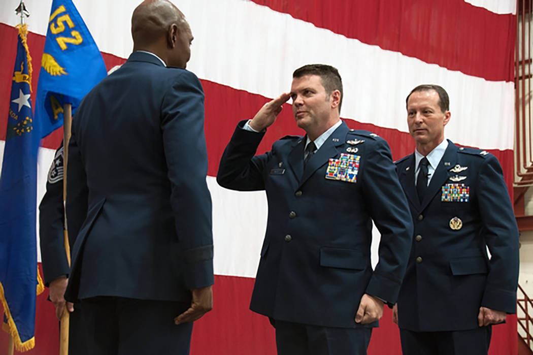 Tech. Sgt. Emerson Marcus/Nevada National Guard Col. Eric Wade, center, assumes command of the 152nd Airlift Wing during a ceremony this spring at the Nevada Air National Guard Base fuel cell hang ...