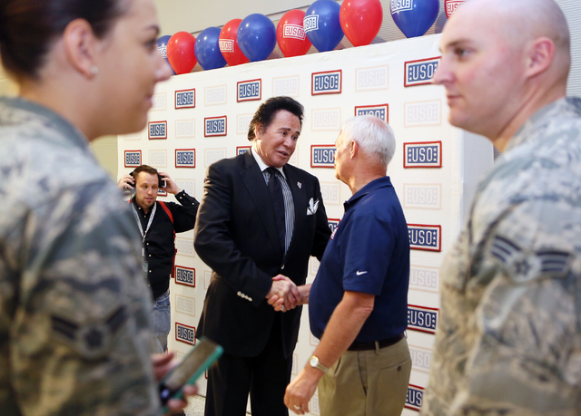 Ronda Churchill/Las Vegas Review-Journal Entertainer Wayne Newton, center left, shakes hands with Al Kaste, USO area director, during the grand opening of McCarran International Airport's Terminal ...