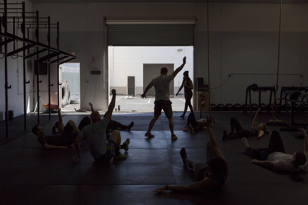 Bridget Bennett/Las Vegas Review-Journal file Drew Pollner, center, leads an exercise during a training session at Project Fitness in Southern Nevada earlier this year. Sports Editor Vern Hee writ ...