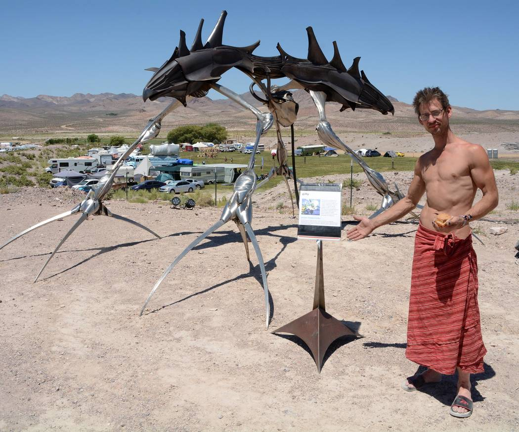 "Richard Stephens/Special to the Pahrump Valley Times Artist Orion Fredericks with his sculpture ""Gllly"" at the Southern Nevada Regional Gathering. He calls himself an elemental artist. He said tha ..."