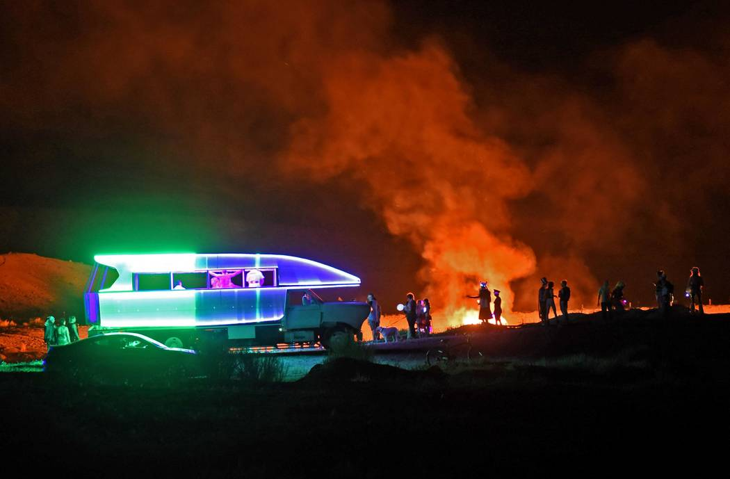 Richard Stephens/Special to the Pahrump Valley Times People dancing in and around the Dancetronoauts vehicle during the burn with this photo taken from the other side with the burn going on in the ...