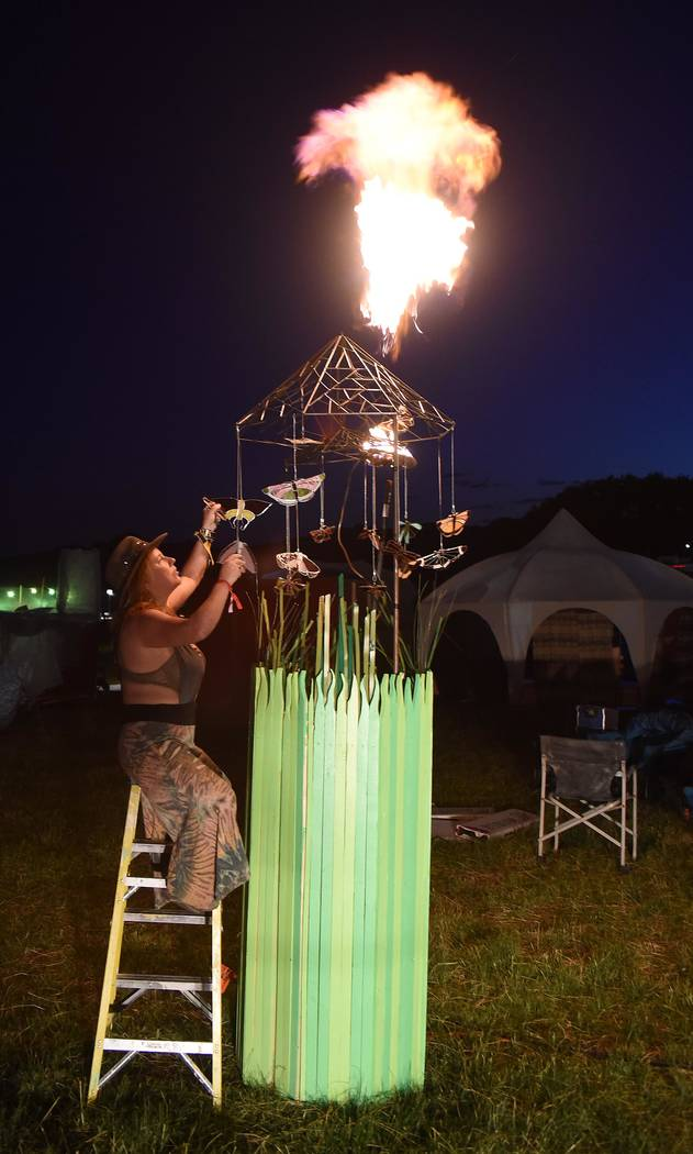 """Richard Stephens/Special to the Pahrump Valley Times Lisa Stark with """"Moths 2 the Flame"""" poofing flame at the Southern Nevada Regional Gathering."""