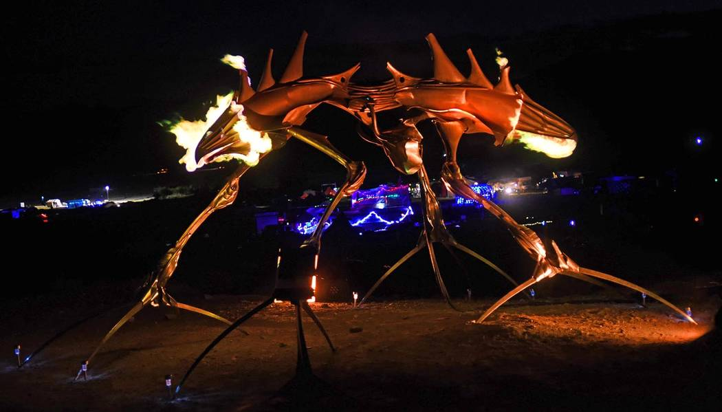 "Richard Stephens/Special to the Pahrump Valley Times Orion Fredericks' ""Gully"" flaming with the lights of the theme camp in the background at the Southern Nevada Regional Gathering."