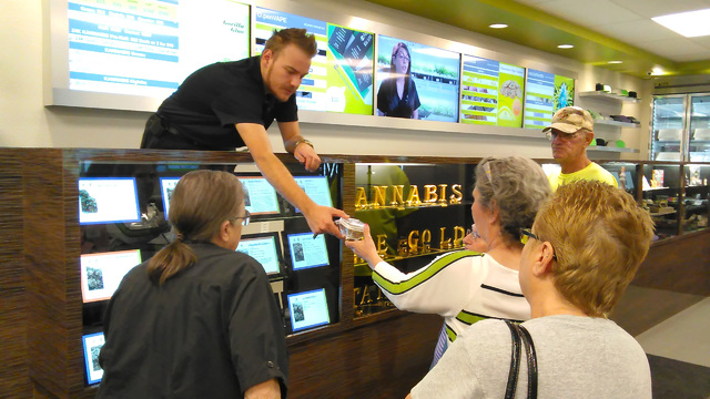 Selwyn Harris/Pahrump Valley Times Grove dispensary Manager Zachary Wright provides information on medical marijuana. The facility opened its doors to Pahrump seniors last week who want to learn m ...