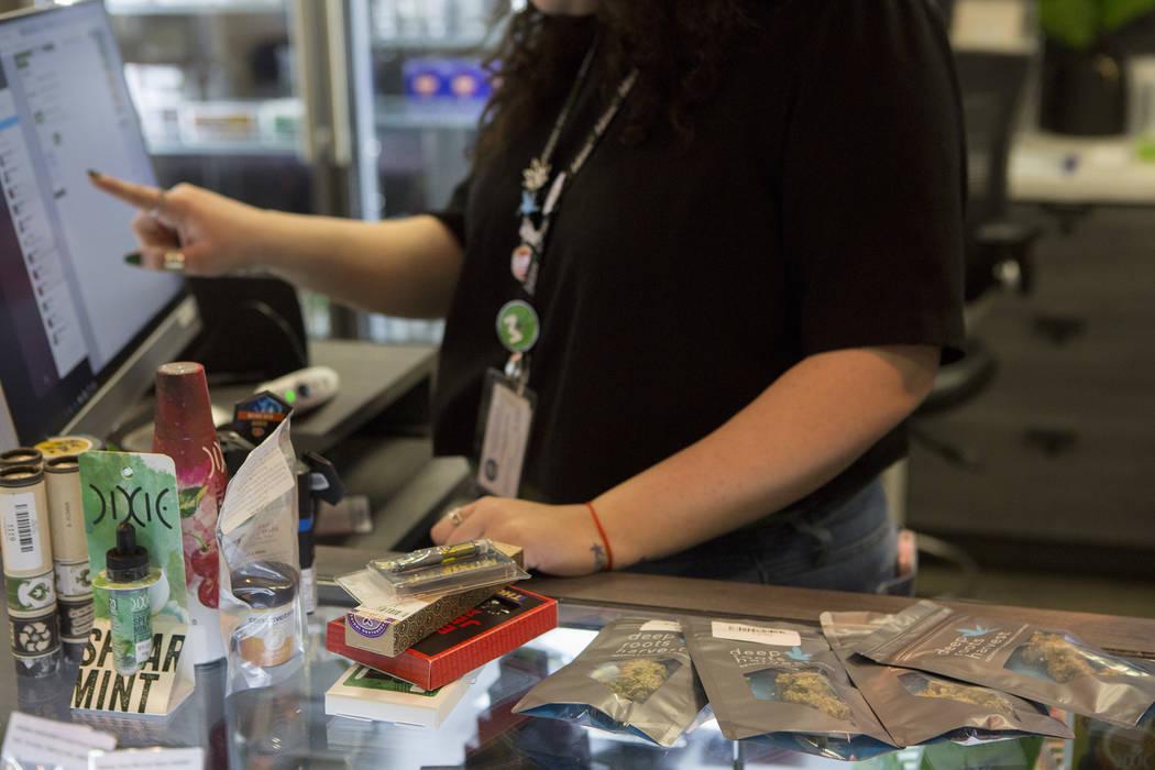 Bridget Bennett/Las Vegas Review-Journal Budtender Maria Ruiz rings up a customer at BLM Las Vegas Medical Marijuana Dispensary on Wednesday, March 1, 2017, in Las Vegas.