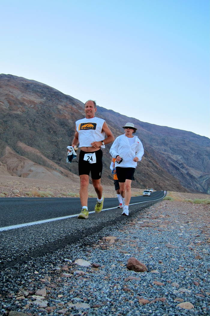 Courtesy of Marshall Ulrich Marshall Ulrich  Marshall Ulrich runs in the Badwater race during the 2012 race with his crew member Perry Gray running behind him. Ulrich says he couldn't do this ra ...