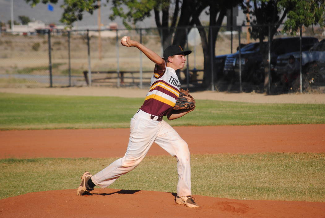 Charlotte Uyeno/Pahrump Valley Times Jakob Feiner pitching against the Summerlin Panthers on June 21. The Trojans split the doubleheader. The Trojans are in first place and are 9-4 going into the  ...