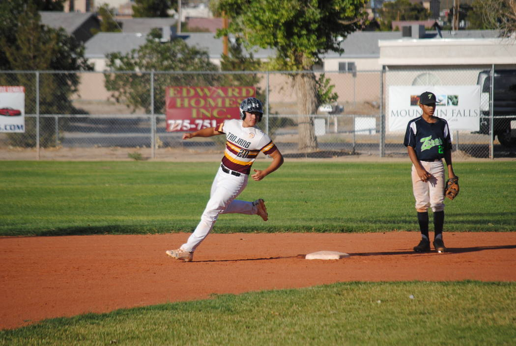 Charlotte Uyeno/Pahrump Valley Times Ian McRae gets a stolen base against the Panthers.  The Trojans came up with at least one win in the double