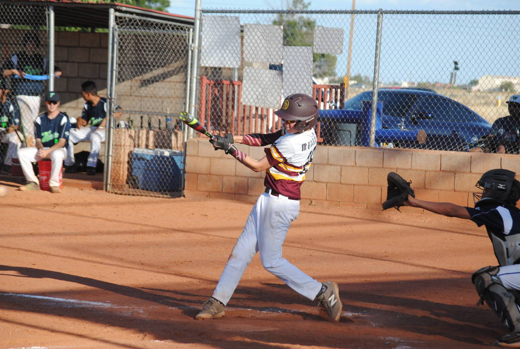 Charlotte Uyeno/Pahrump Valley Times Short stop Chase McDaniel at bat during the Summerlin game. McDaniel made the Trojans high school team as a freshman.