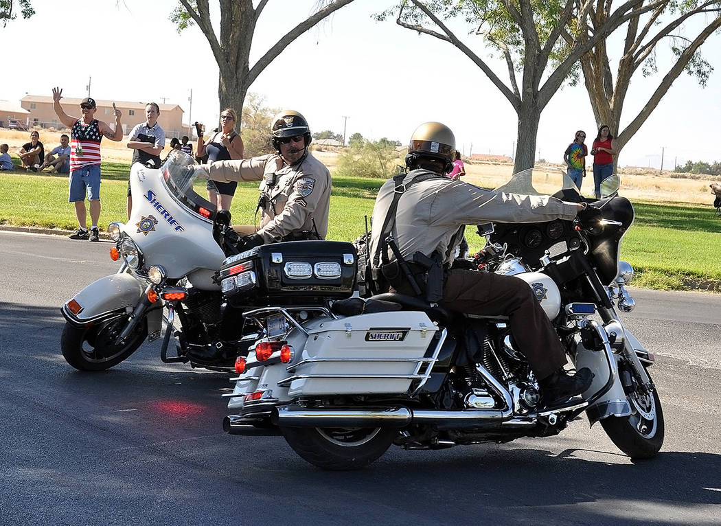 Horace Langford Jr./Pahrump Valley Times- 4th of July parade, NCSO motor officers perform
